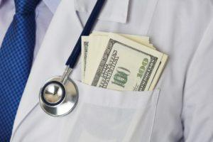 Male Medicine Doctor Chest With Bunch Of Hundred Dollars Banknot