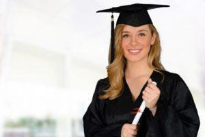 Young successful woman graduating from college holding a diploma